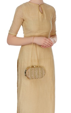 Gold oval shaped zardozi clutch