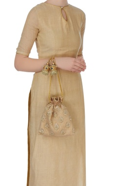 beige oversized polti in gold sequins