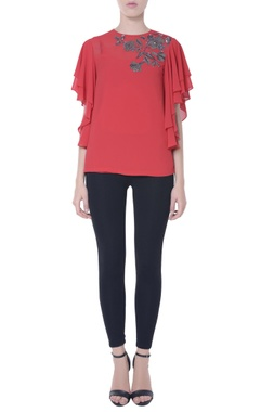 Coral red blouse in sequin embellishments
