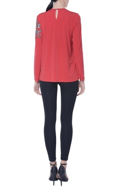 Red ruffle flap style top