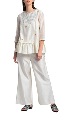 White frilled style top
