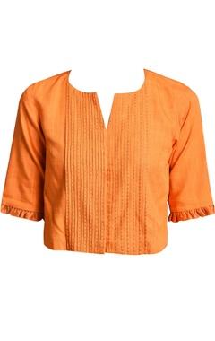 orange pleated style blouse