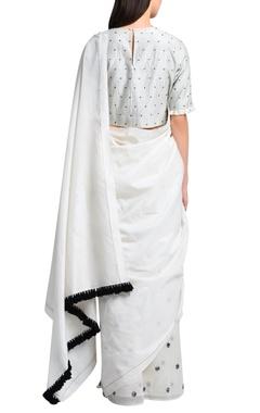 White sari in hand embroidery