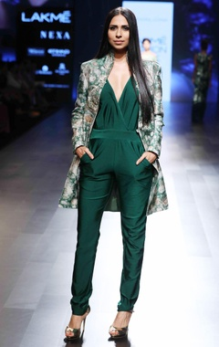 green jumpsuit with a deep neckline