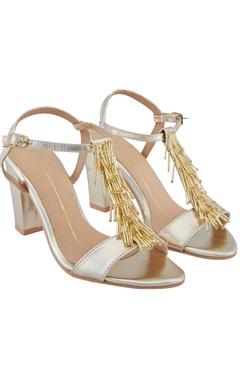 Nidhi Bhandari Gold t-strap 3-inch block heels