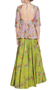 green lehenga with purple peplum blouse