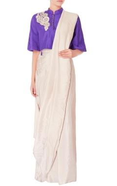 cream pre-draped sari with purple blouse
