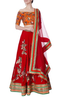 orange velvet blouse & red lehenga set