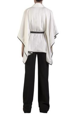 White lurex poncho with belt