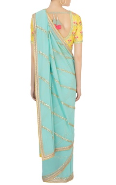 turquoise blue sari with yellow blouse & petticoat