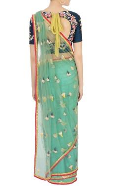 green net sari with blue blouse & petticoat