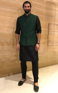 black silk kurta and churidar set with green bandi