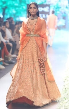 Orange raw silk & organza embroidered lehenga with tea green belt