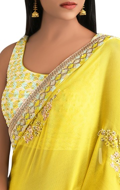 yellow hand embroidered net sari with blouse