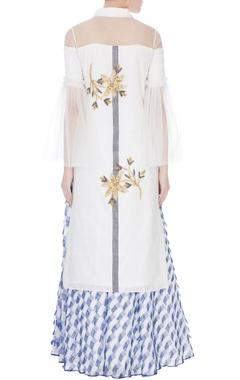 white embellished kurta with blue frayed patch skirt
