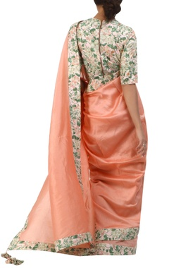 salmon pink jaal printed border sari with embroidered cotton blouse