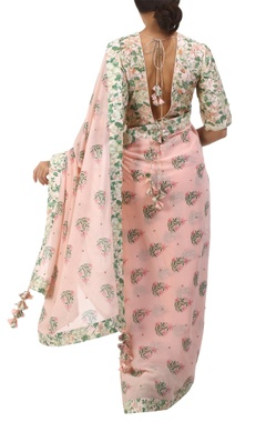 salmon pink georgette bouquet printed sari with blouse
