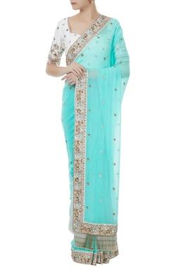 Ice blue & white georgette & tafetta hand crafted zardozi & bead work tassels sari with blouse