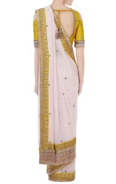 White & sulphur yellow georgette & tafetta hand crafted zardozi & bead work tassels sari with cold-shoulder blouse