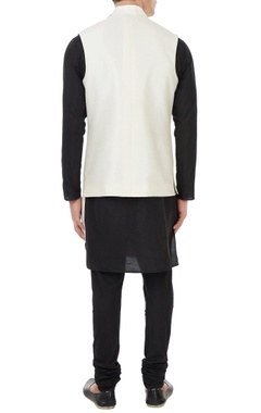 Cream raw silk asymmetric turtleneck collar jacket