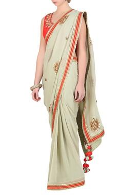 Jade green gota patti saree with coral dupion silk blouse