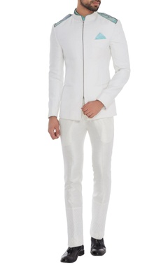 White cold-shoulder chino jacket with blue shirt & white trousers