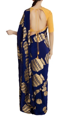 Blue crepe silk gold vase motif sari with yellow unstitched blouse
