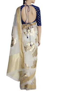 Ivory saree in oversized fish motifs with blue blouse piece