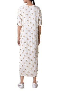 Off-white maxi shirt dress with gold pom-pom accents