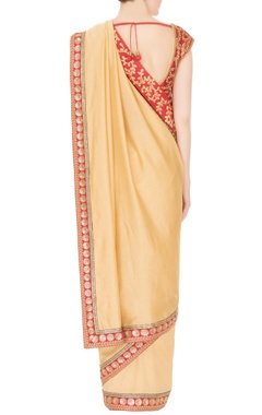 Gold silk & crepe zari & pearl work saree with red blouse