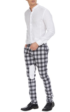 Paresh Lamba Checks pants with oval knee patch.