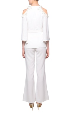 White cold-shoulder shirt with flared pants