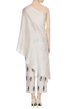 Beige thread embroidered & pearl one-shoulder silk kurta with printed cigarette pants