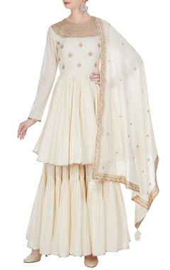Punit Balana Embroidered short flared anarkali with gharara and dupatta.