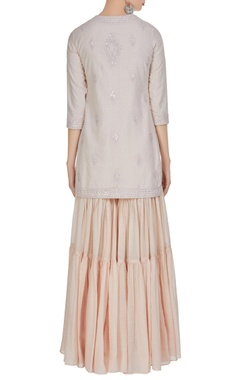 Embroidered short kurta with ruffle layered gharara set.