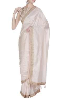 Punit Balana Embroidered sleeveless blouse with lace border saree.