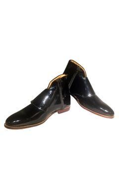 Black patent leather boots with decorative belt buckles