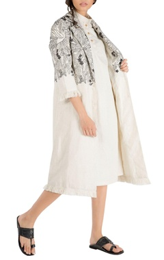 Nakita Singh Ivory tropical embroidered trench jacket with frayed edges