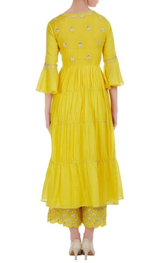 Tiered pleated kurta with embroidered palazzo and dupatta.