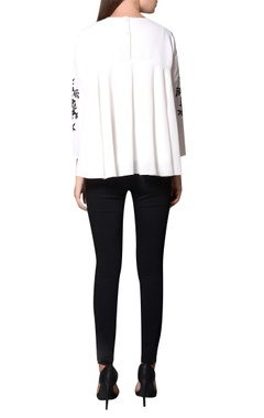 White pleated moss crepe style embroidered blouse
