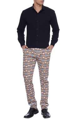 White kaleidoscopic leaf printed trousers with adjustable hem