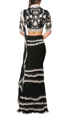 Midnight black draped saree with layered skirt and peplum blouse