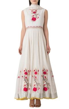 White cotton anarkali kurta with embroidered floral motifs.