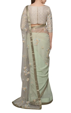 Pastel green floral embroidered net sari with blouse
