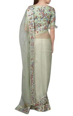 Pastel green organza dori embroidered sari with blouse