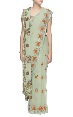 Haze green chiffon sari with sequin and threadwork details.