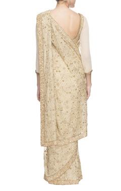 White and golden sequined chiffon sari