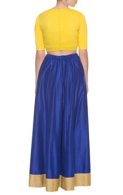 blue skirt with embroidered yellow top