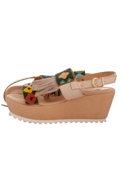 Beige platform wedges with tribal beadwork pattern