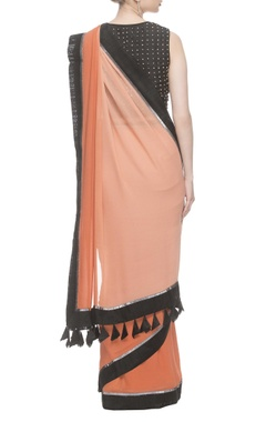 Orange & peach shaded sari with black studded blouse